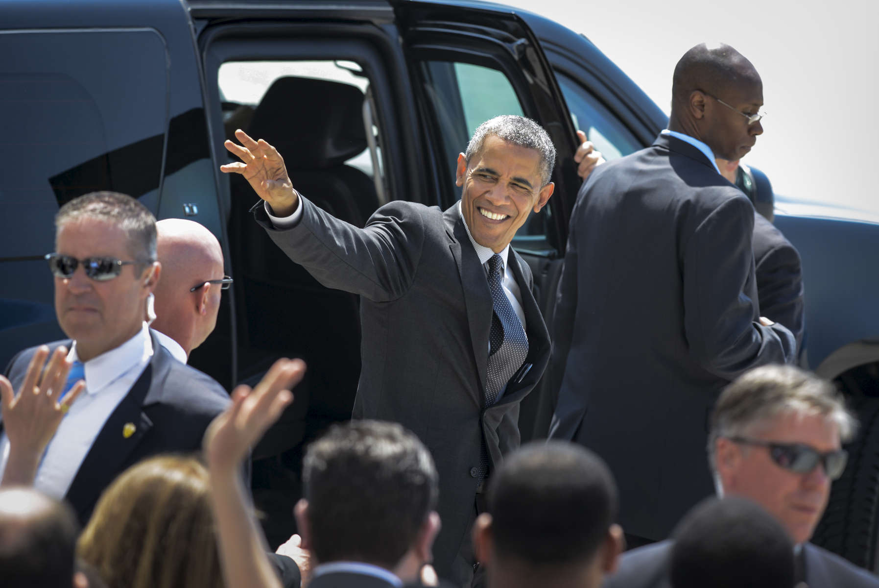 "President Barak Obama waves to a crowd of supporters as he is escorted on the tarmac of John F. Kennedy International Airport from Air Force One to Marine One on May 4, 2015. The President was visiting New York City to do, among other things, visit Lehman College in the Bronx to launch the expansion of the My Brother's Keeper Alliance initiative about race relations and opportunity, and a guest for an eight and final time on CBS' ""Late Show with David Letterman."""