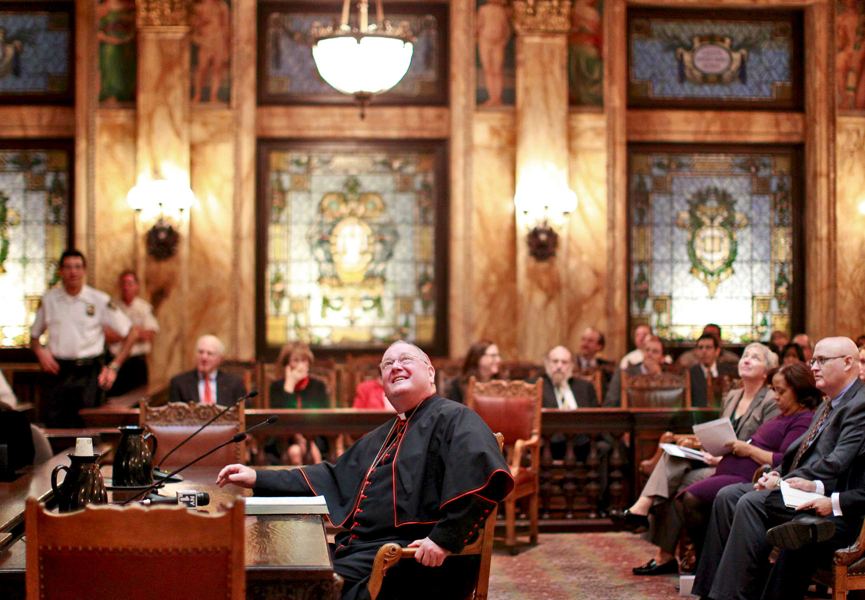 Cardinal Timothy M. Dolan, archbishop of New York, testifies about legal services for low-income residents during a public hearing held inside Supreme Court's Appellate Division located at 27 Madison Avenue in Manhattan, New York on Monday, October 1, 2012.