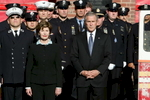 United States President George W. Bush and First Lady Laura Bush attend the 9-11 Tribute Ceremony honoring first responders outside Engine 15 Ladder 18 4th Battalion Chief Fire Station at 25 Pitt Street in Manhattan on Monday September 11, 2006. The President and First Lady spent their breakfast with first responders after attending the somber ceremony.