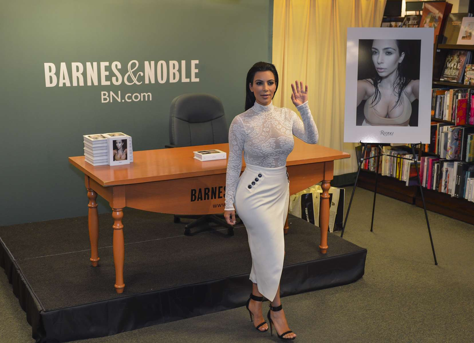 Kim Kardashian poses for photos inside Barnes & Noble at 555 5th Avenue in Manhattan before her book signing on Tuesday, May 5, 2015.
