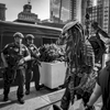 A person wearing the Predator costume, based on the movie Predator starring Arnold Schwarzenegger, walks by members of the NYPD Emergency Service Unit at the New York City Comic Con held at the Jacob K. Javits Convention Center located at 655 W. 34th Street in Manhattan on Friday, October 6, 2017. The New York Comic Con attracts thousand of spectators, comic books and sci-fi fanatics.