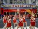 Radio City Rockettes stop traffic in front of Radio City Music Hall, as they promote the 2017 {quote}Christmas Spectacular Starring the Radio City Rockettes, presented by Chase{quote} along 6th Avenue between West 50th and West 51st Street in Manhattan on Thursday, August 17, 2017.