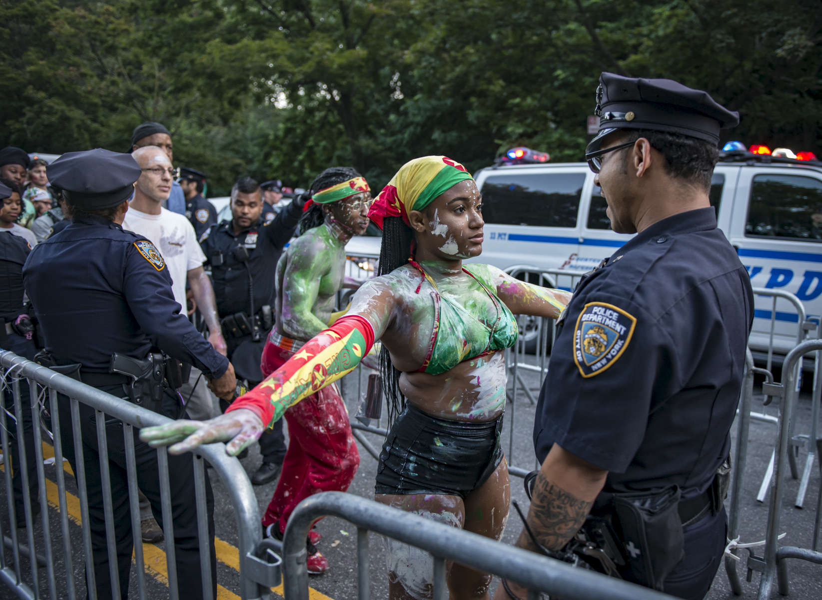 Parade participants go through NYPD check point as they arrive at the annual J'Ouvert Parade held in Crown Heights, Brooklyn on Monday September 4, 2017. The pre-dawn festival of J'Ouvert that translates to {quote}day break{quote} is celebrated by people of West Indian decent to mark the start of the Caribbean carnival celebrations. (Anthony DelMundo/New York Daily News)