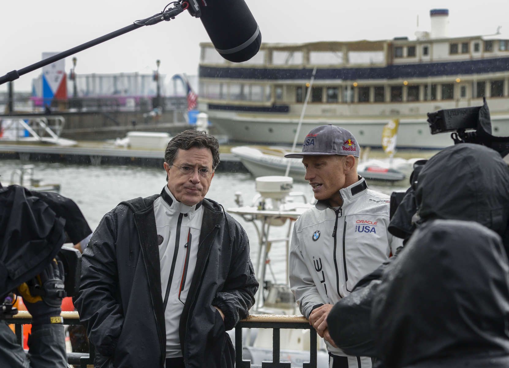 The Late Show host Stephen Colbert (left) interviews James Spithill (right), two time America's Cup Winning skipper for Oracle Team USA on the opening day of America's Cup sailing competition at the Waterfront Plaza Brookfield Place located at 230 Vesey Street in Manhattan, May 6, 2016.