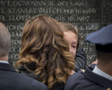 Tears flows on the check of a girl as she joins family and relatives of fallen members of the NYPD as NYPD honors cops lost in the line of duty by unveiling their engraved names at Battery Park Police Memorial Wall located at 285 South End Avenue in Manhattan on Friday, October 13, 2017.