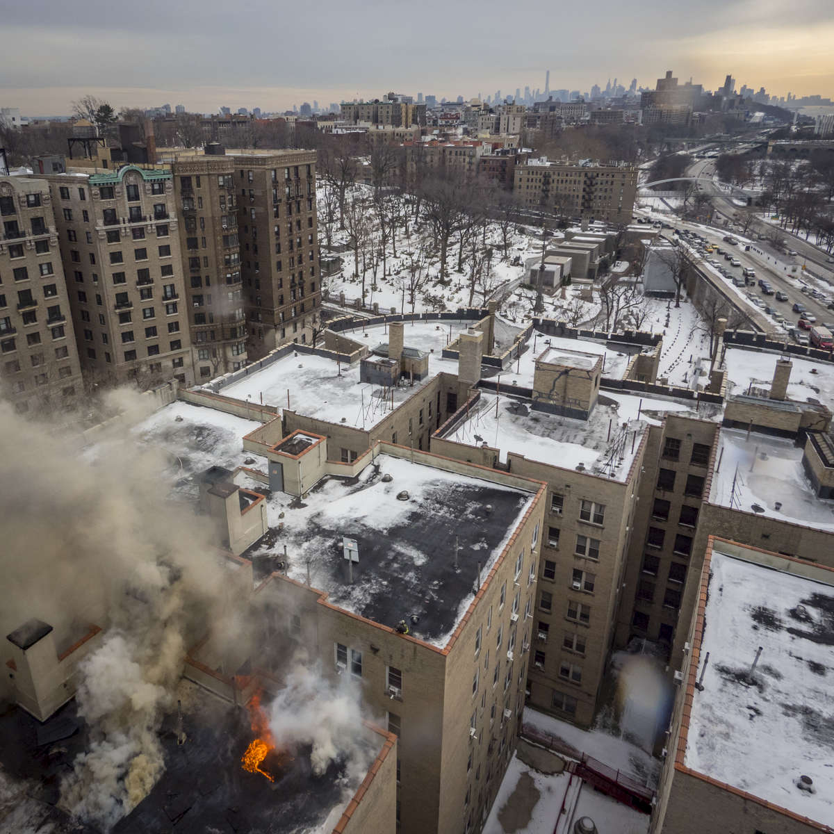 Firefighters battle a 7-alarm fire in a building located at 775 Riverside Drive in Manhattan on Monday, January 8, 2018.