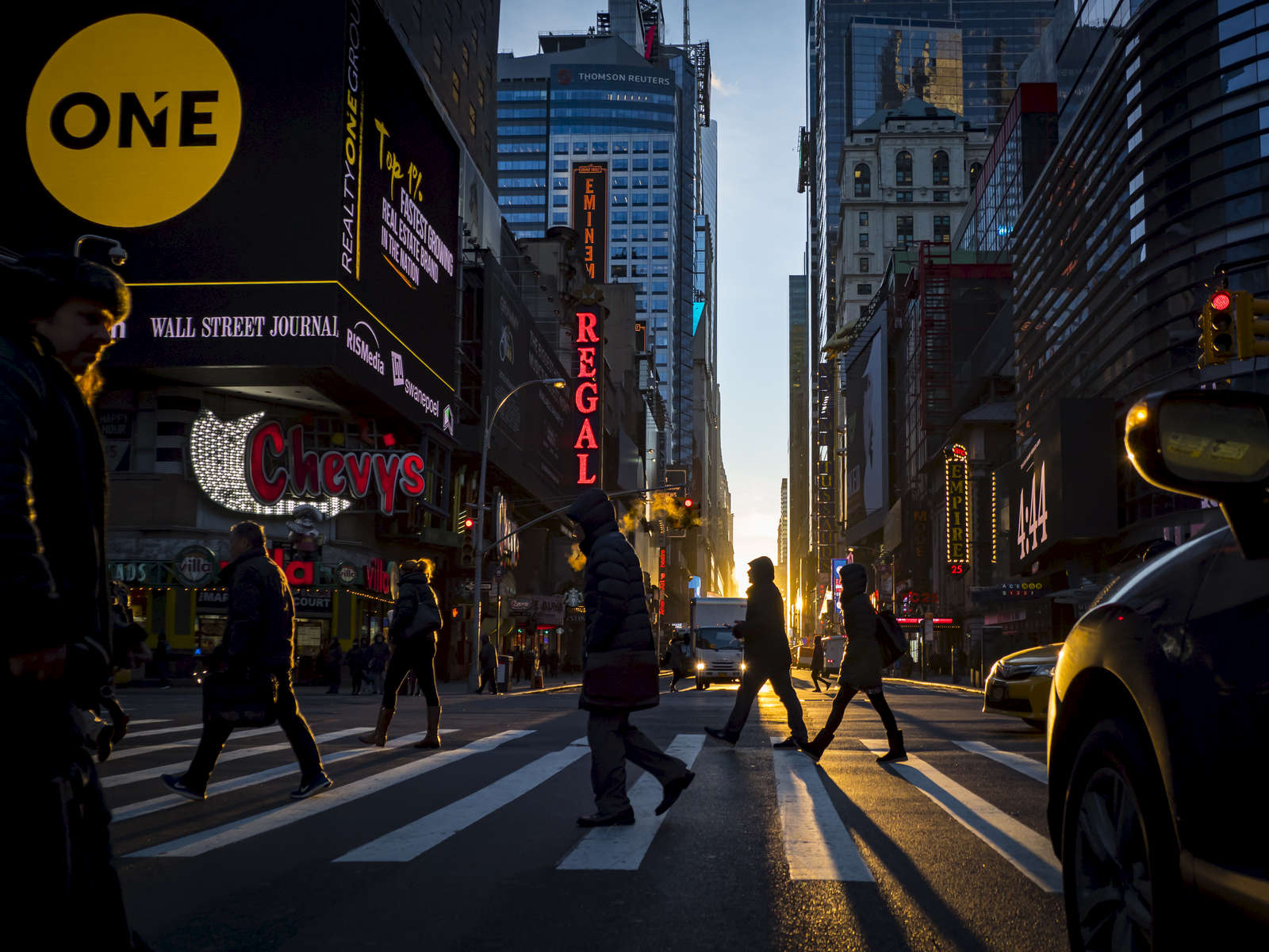 Pedestrians were silhouetted as they cross 42nd Street and 8th Avenue in Midtown, Manhattan on Thursday, January 25, 2018.