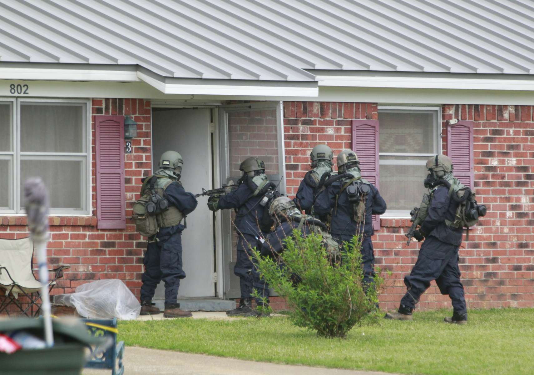 Federal agents wearing hazmat suits raided the home of Paul Kevin Curtis,45, who was arrested for allegedly sending letters containing ricin to President Barack Obama and Senator Roger Wicker, R-Mississippi, located at 802 Redwood Drive in Corinth, Mississippi on Thursday, April 18, 2013.