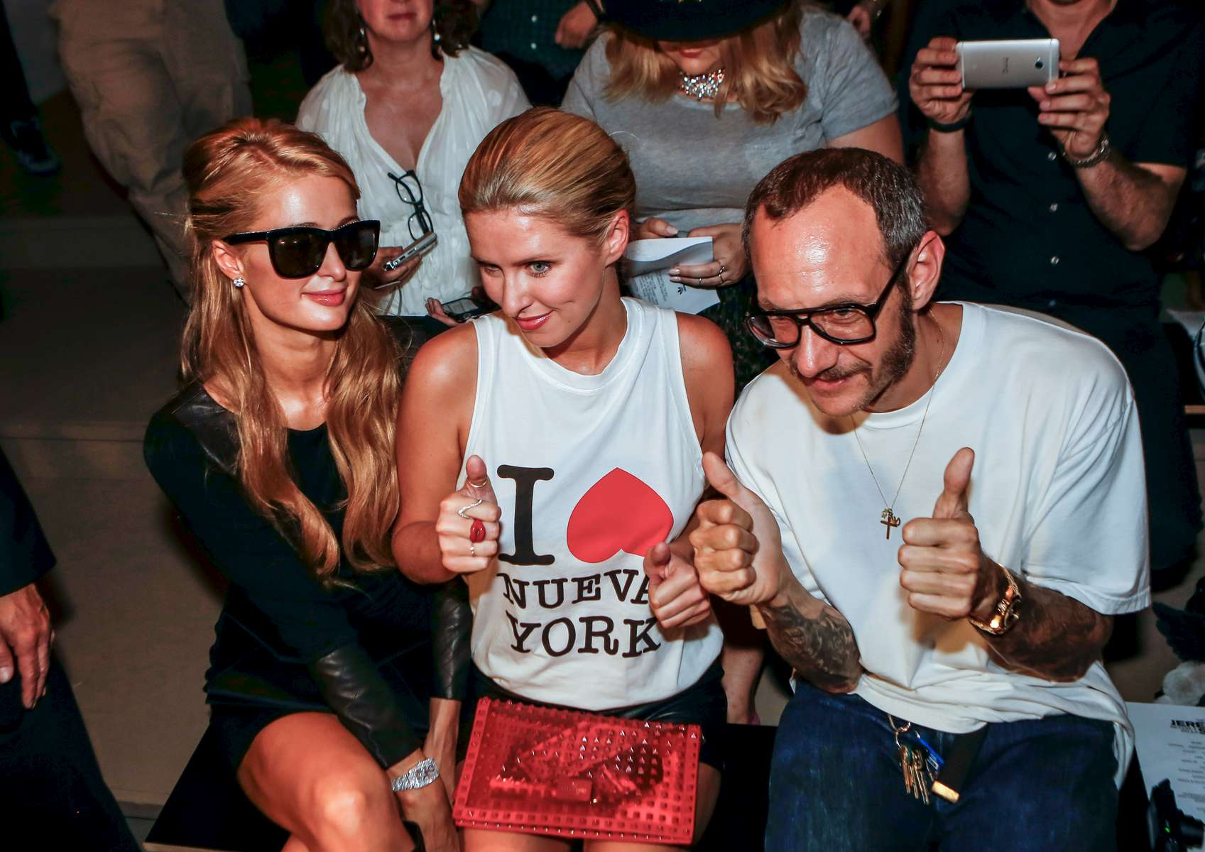 Paris and Nicky Hilton was joined by celebrity photographer Terry Richardson (right) as they attend the Jeremy Scott runway show at 450 W. 15th St, for New York Fashion Week Fall 2013