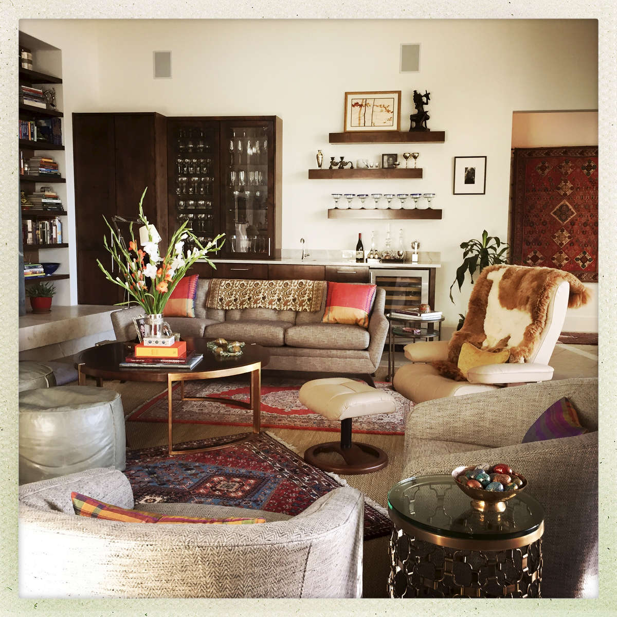 Collections of textiles and rugs are colourful highllghts to the this gathering space.