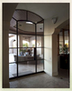 A regular doorway was redefined with a wall of glass from Portella.  The archway thresholds are accented with pewter.