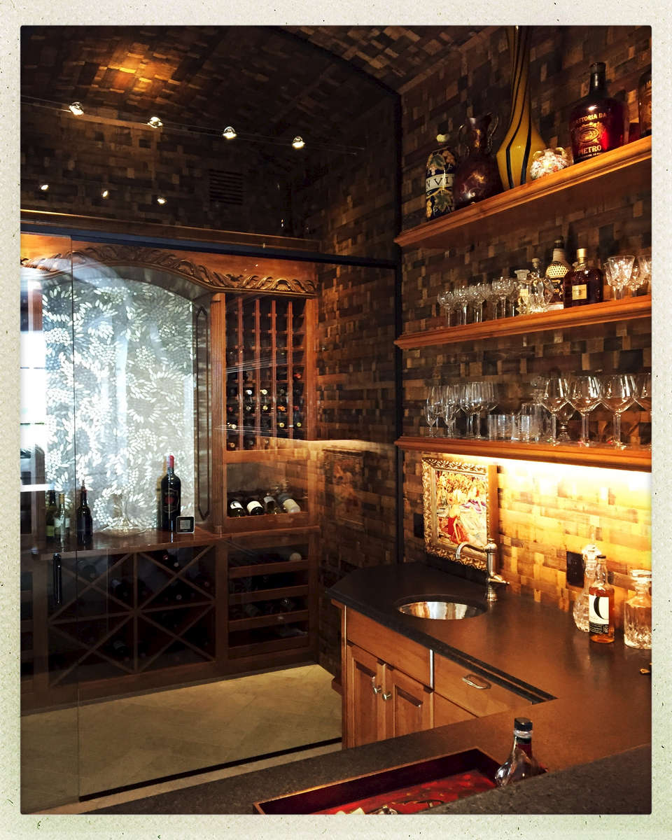 The walls are lined with wine-stained staves and the backsplash is from SICIS...it's all about the materials.