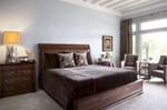 The ceiling beams were added to bring the comfort of Tuscany to the bedroom.