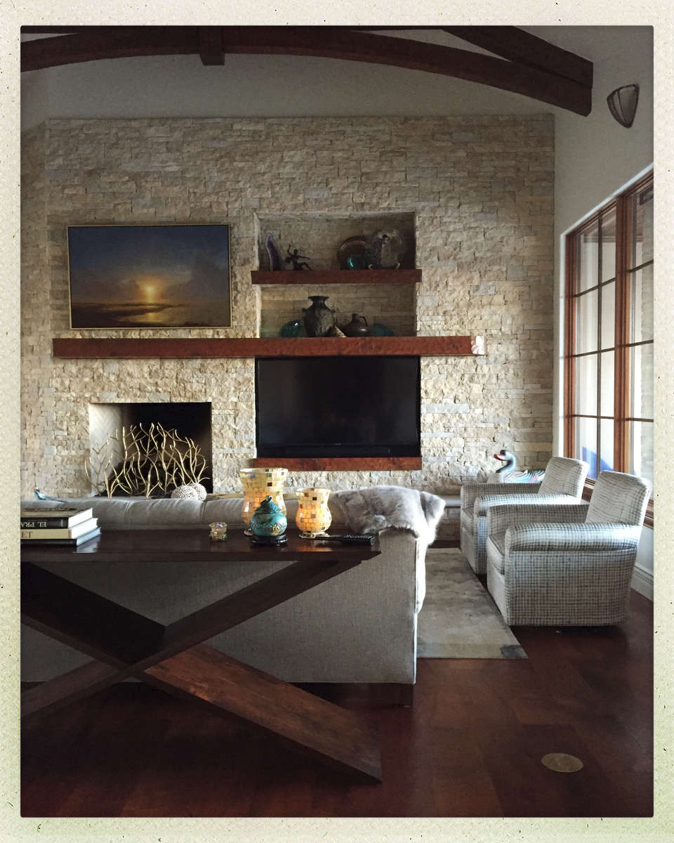 This fireplace was designed to divert the eyes from that 60{quote} screen.