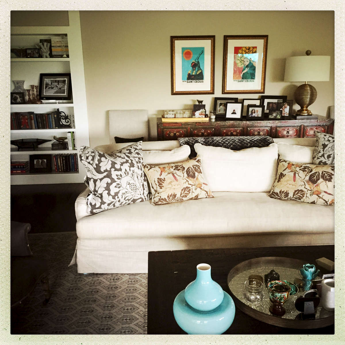 I provided a new layout for the room, new pillows, rug, and blankets.  The artwork was reframed to celebrate an Austin institution, while the lamp was a local find.