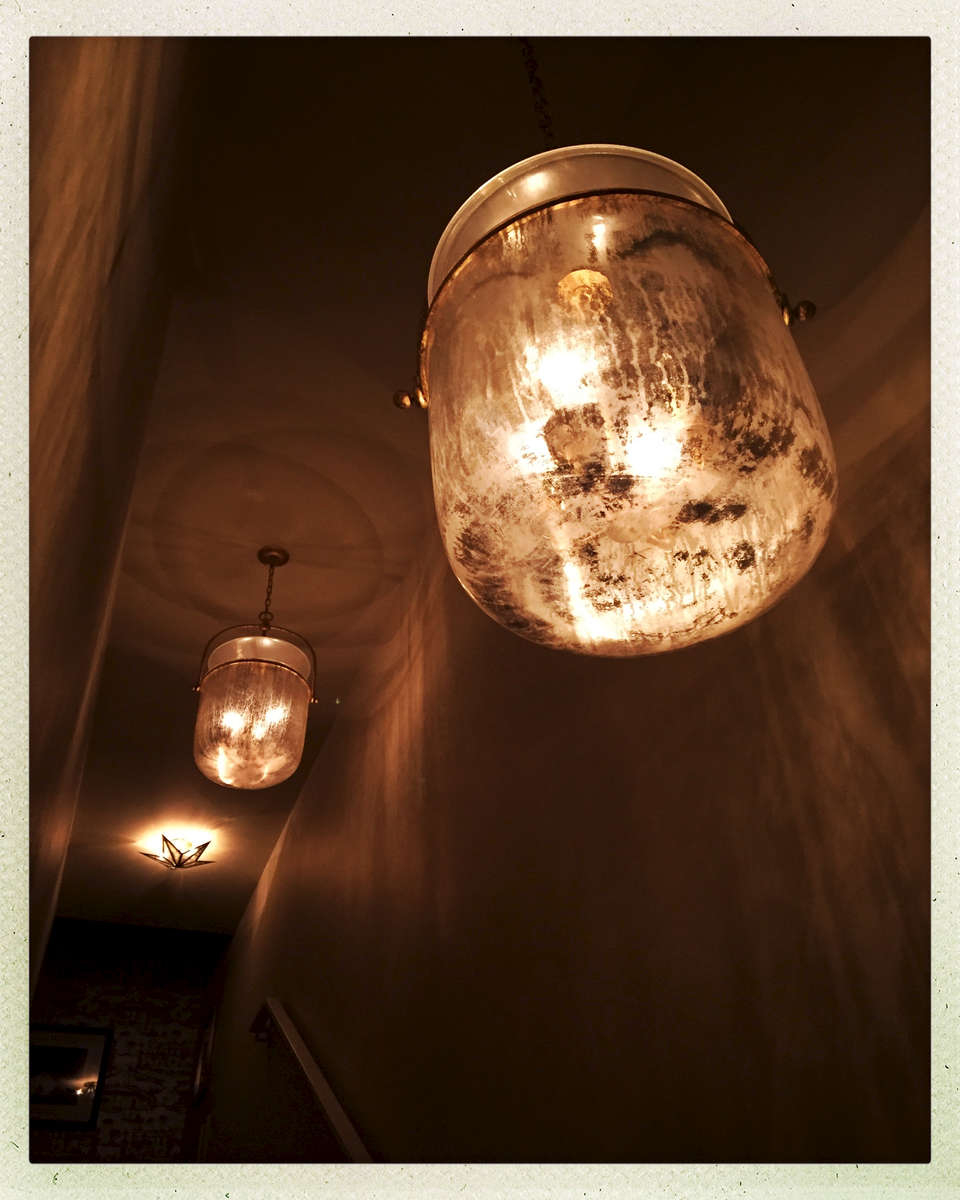 These mercury-infused smoke bell lanterns lilluminate the way and add {quote}light{quote} texture to the walls.
