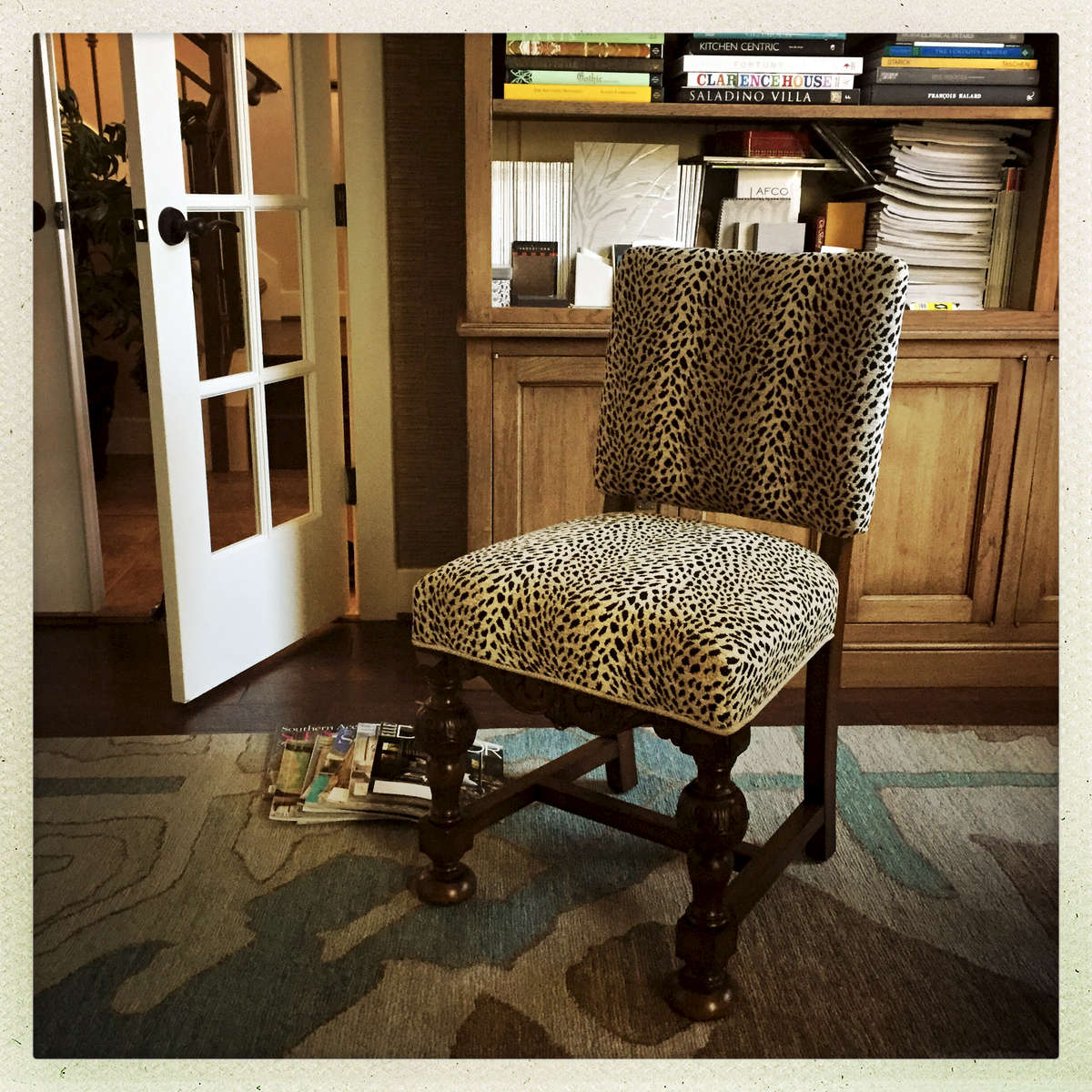 It seemed appropriate to use the last yard of a Larry Lazlo fabric on the overflow antiique dining chair.  Sure there's only one, but it's a showstopper.