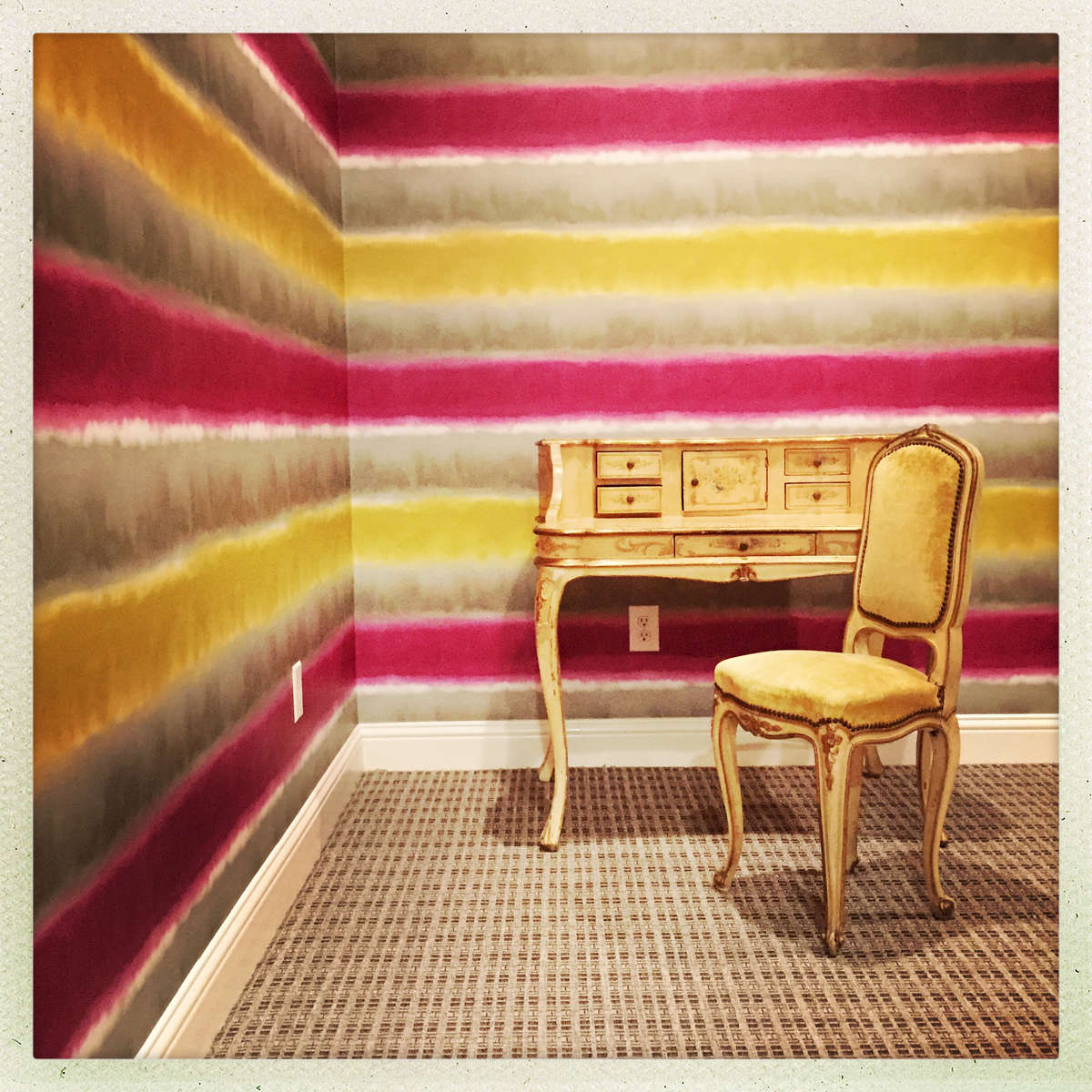 It just worked out that the 19th Century vanity and chair happened to match the 21st Century wallpaper.