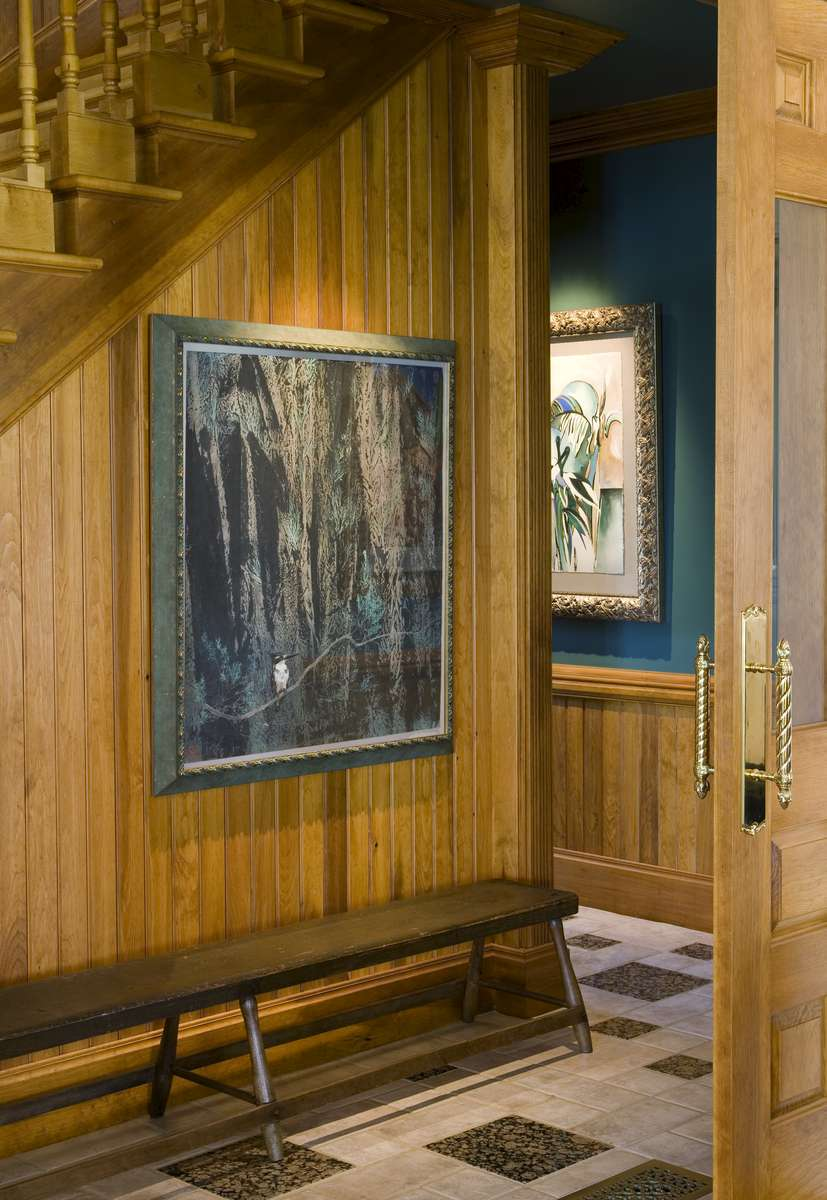 A 19th Century bench waits in the hall with a painting collected in China, from a 1987 adventure.  Beyond is a painting from The Outback of Australia, circa 1985.