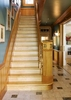 The stairs were rebuilt to code with styles from patterns in catalogs of the 19th century.  The wainscoting is individual beaded boards of clear pine.  The hall floors are italan tiles with inset granite tiles to be garden steps.  The logo of brass was made in Lunenburg.