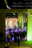 Guests move into dinner as the walls move aside to reveal the rest of the room at the University of Vermont Foundation Campaign Gala. Event design by Feats Inc.