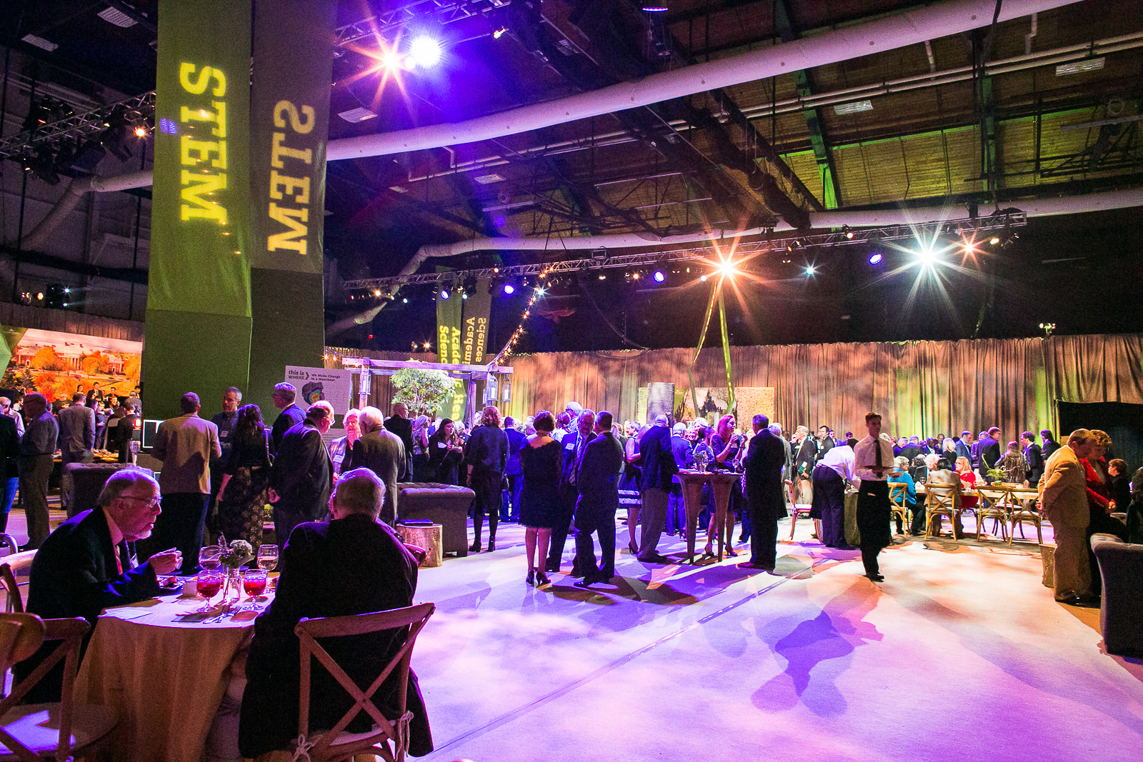 Guests enjoy food and drink at the University of Vermont Foundation Campaign Gala. Event design by Feats Inc.