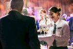 A server gives a guest a drink at the University of Vermont Foundation Campaign Gala. Event design by Feats Inc.