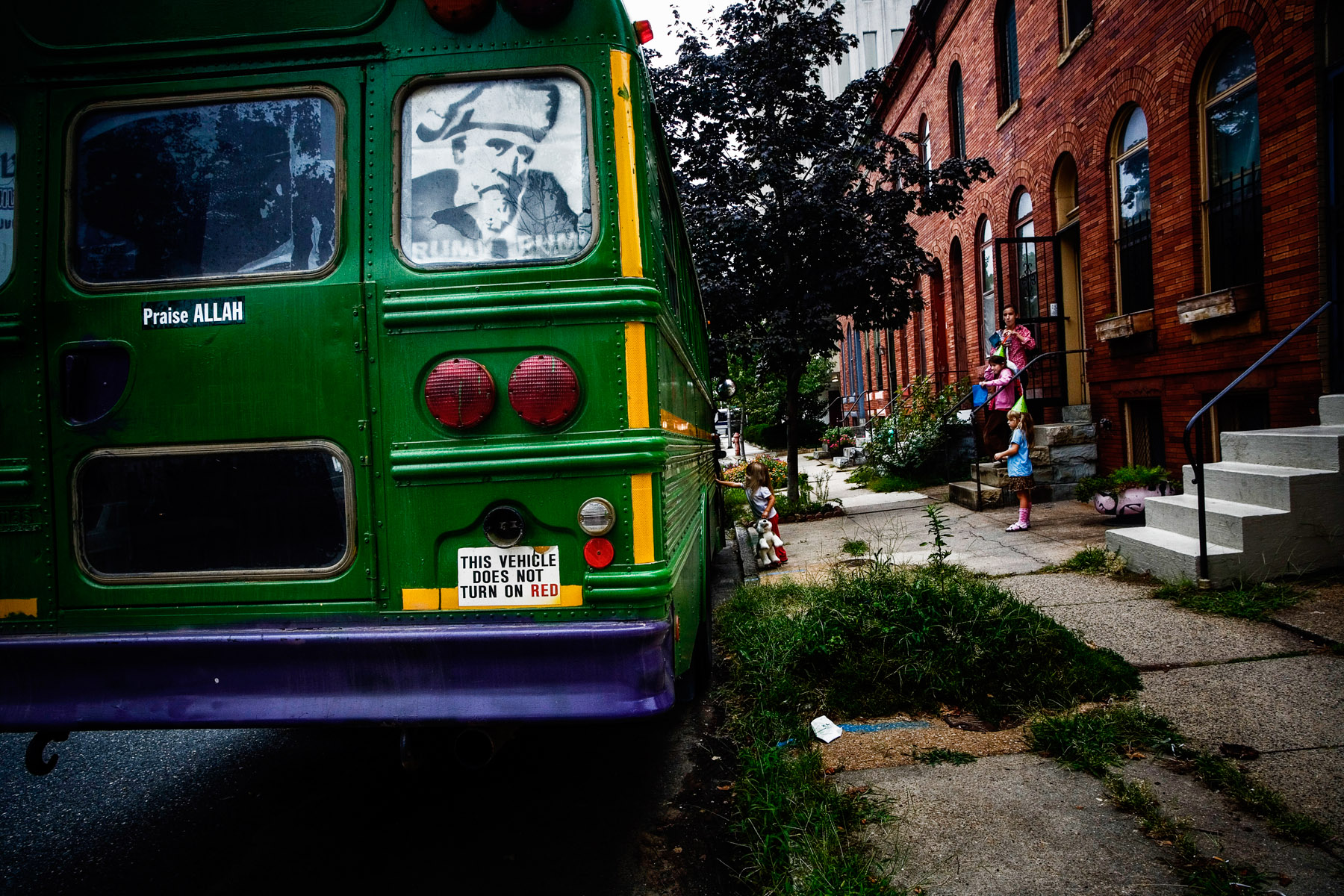Birthday girl examines the Taqwa-bus infront of St. John's Church on in Charles Village. The church  organized in a functional cheuch, organized by Red Emma's, also featured Vote Hezbollah, al-Thawra, and Omar Waqar, formerly of Washington-based Diacritical. The Kominas are interviewed by Voice of America.Michael Mohammad Knight, and five Taqwacore bands embark on the world first ever Muslim punk musical genre tour, across Northeast of the USA in August of 2007.   The Taqwacore Bands are: Vote Hezbollah, The Kominas, Omar Waqar from DiaCritical, Al Tharwa, Ze Beoble and Secret Trial Five .