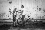 Syrian refugee, Armin argues with Brazilian man, wearing a Isreal cap about where to park his bicycle in the parking lot of Sao Joao de Bastista church in the commercial neighborhood of Botafogo in Rio de Janeiro.