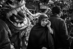 CAIRO, EGYPT - JANUARY 23 : Local Chinese residents watch as the dragon dance is preformed as part of the celebration for Chinese New Years on Degla Street in Maadi on January 23, 2012 in Cairo, Egypt.
