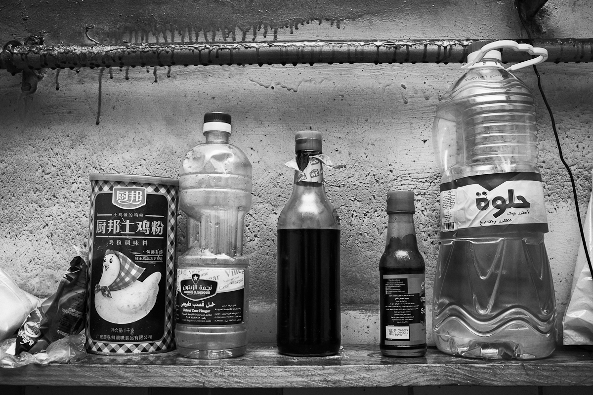 CAIRO, EGYPT - MAY 31 : Detail from a kitchen shelf shared by eight illegal Chinese migrant workers on May 31, 2012 El Geish Square in Cairo, Egypt.