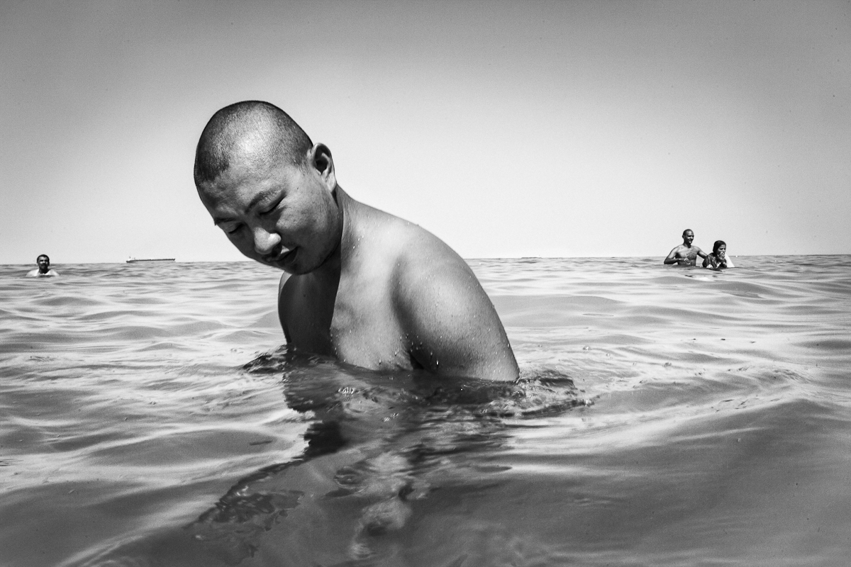 AIN SHOKNA, EGYPT - JUNE 18: Ricky Hou, an engineer at Huawei, a leading global company, goes for a swim in the Red Sea June 18, 2012 in Ain Shokna, Egypt.
