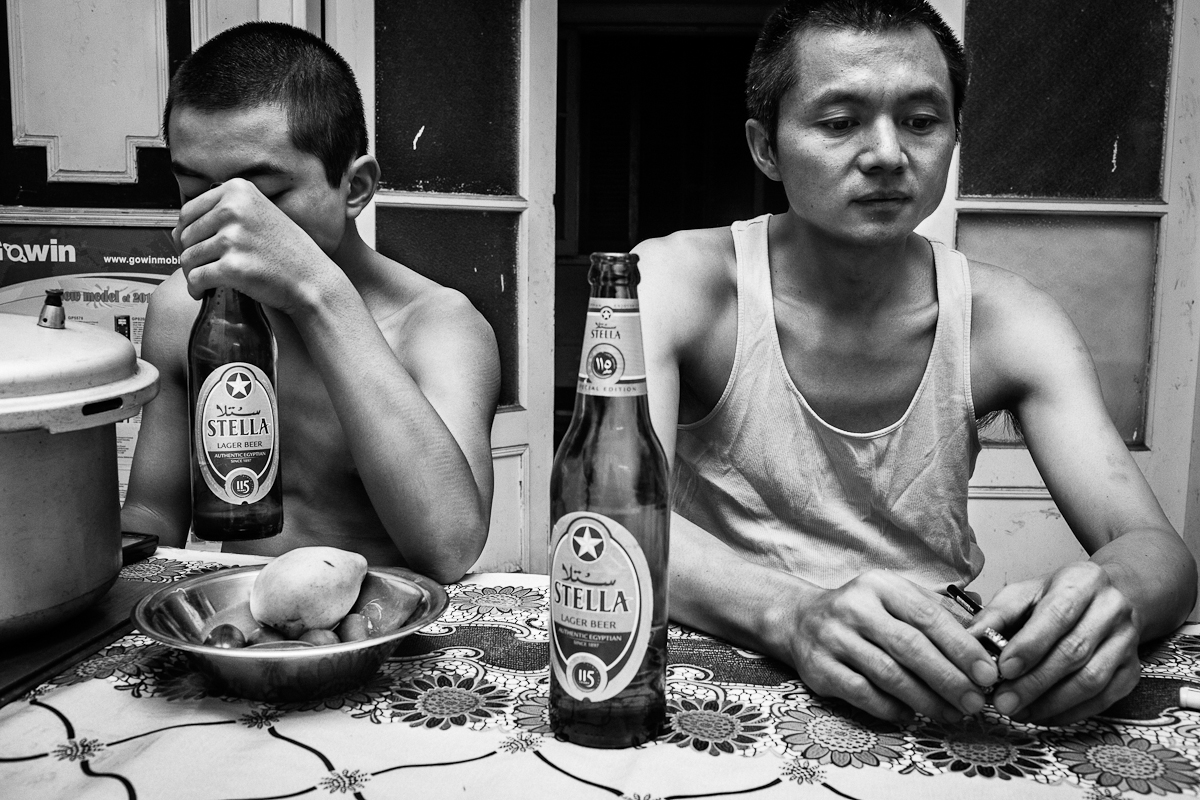 CAIRO, EGYPT - MAY 31 : Wu Qing and his son Qu Qing share an Egyptian Stella beer after after dinner on May 31, 2012 in Cairo, Egypt.