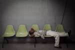 PORT-AU-PRINCE, HAITI - FEBRUARY 11: Dominique Jameson sleeps on waiting room seats at L'Hopital General on February 11, 2010 in Port au Prince .