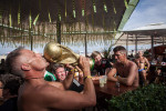 RIO DE JANEIRO, BRAZIL - JUNE 29 : Matthias Muller kisses a fake FIFA World Cup trophy at a kiosk on June 29, 1014, on Copacabana beach in Rio de Janeiro, Brazil. (Photo by Kim Badawi/Global Assignment by Getty Images for Der Spiegel )