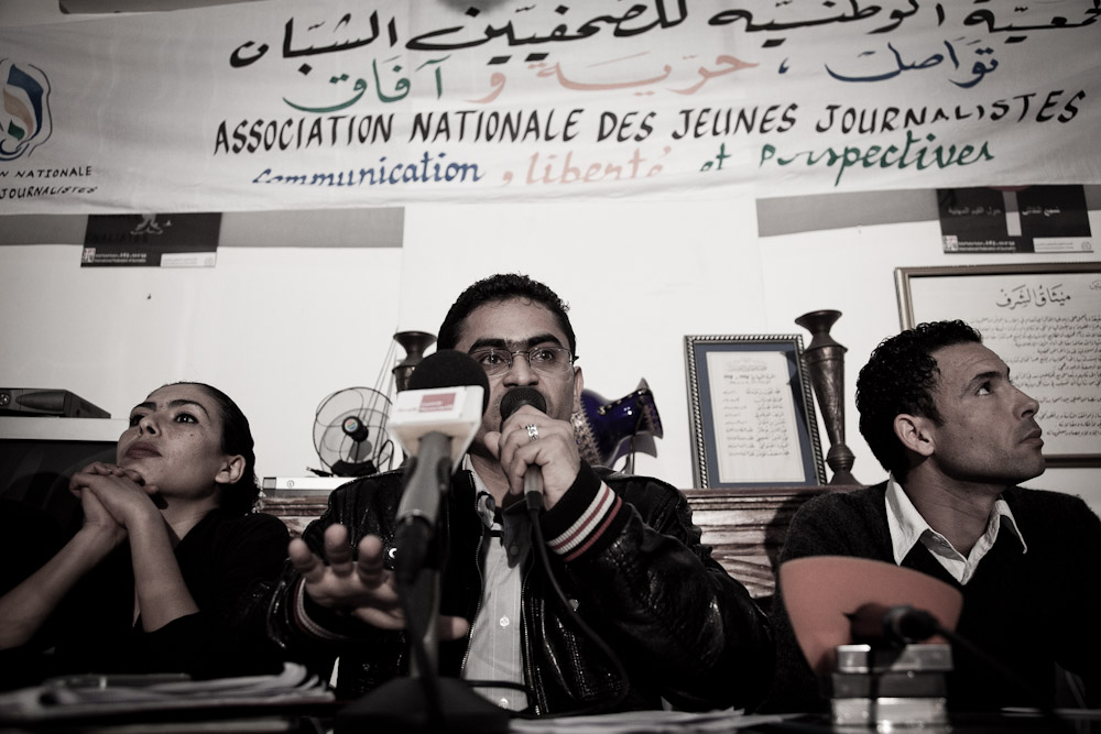 TUNIS, TUNISIA - APRIL 7 : Abdel Raouf Bali, journalist for Achourouk and president of ANJJ ( Association National des Jeunes Journalistes ) speaks at La Maison du SNJT ( Syndicate of National Journalists of Tunisia ) on 7 April, 2011 in Tunis, Tunisia.