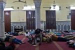 Injured sleep inside Omar Makram Mosque on Tahrir Square in the morning of December 5th. 2011.