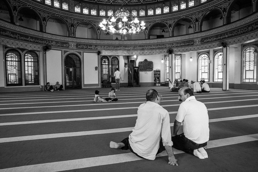 Two Arab men converse after prayer inside Masjid Hanzala mosque South of São Paulo. 2015