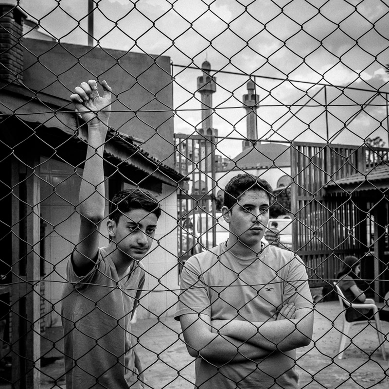 Boys watching cage football outside Hanzala mosque in São Paulo. 2015