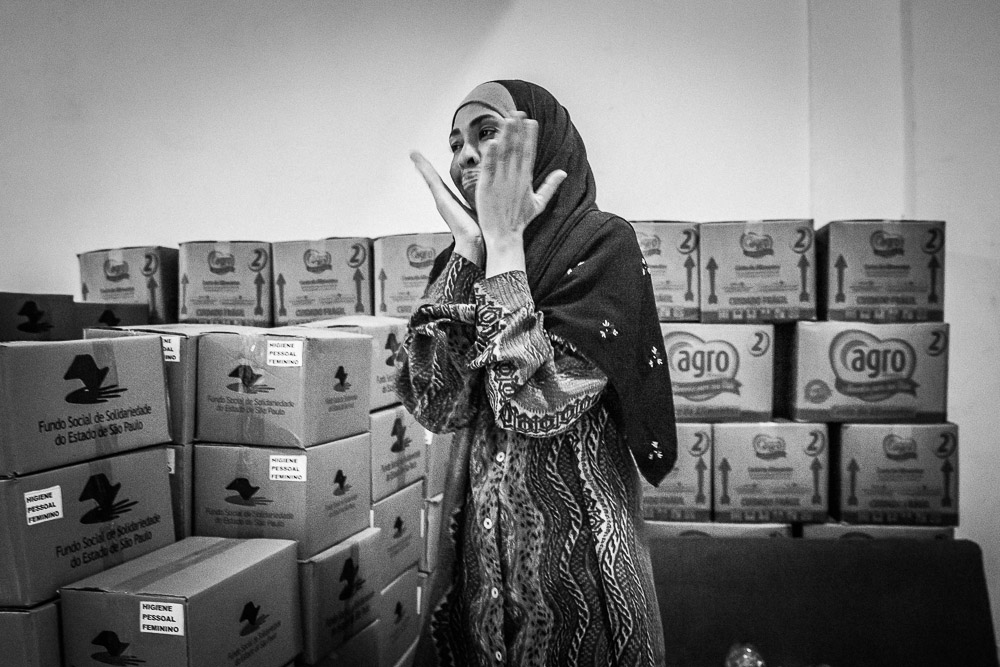 Muslim convert, Carmelita, is overwhelmed seeing the number of donations granted by the State of São Paulo. Carmelita converted to Islam when she was 14 years old. She is originally from Bahia.