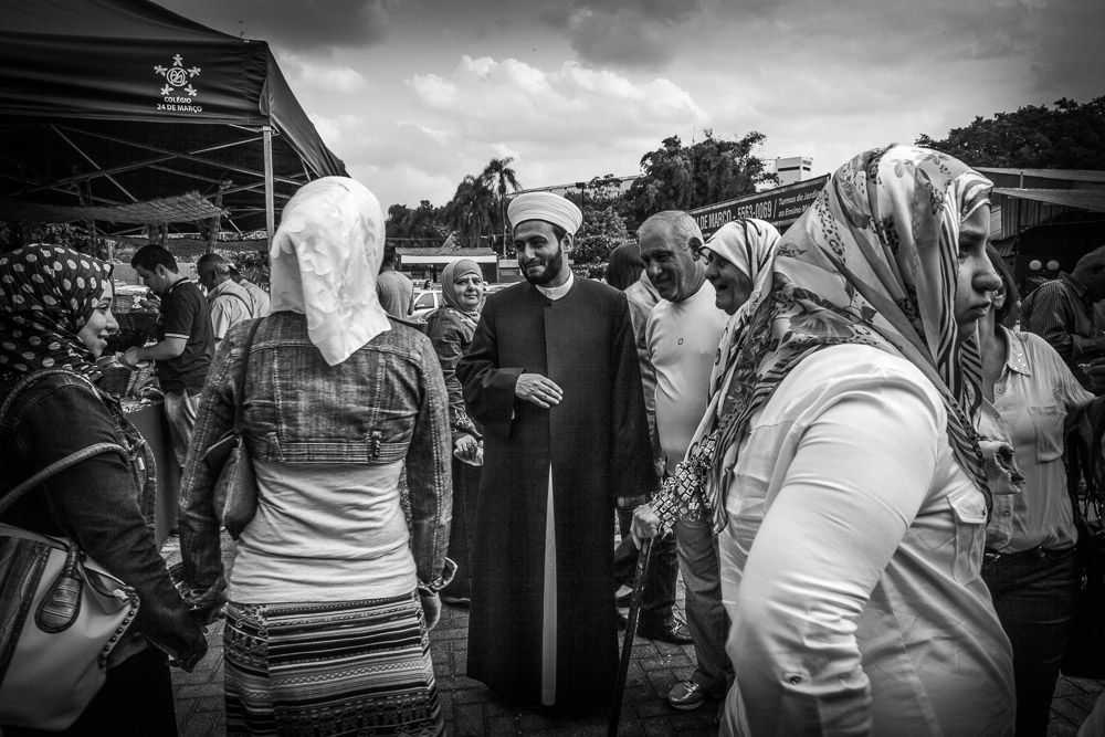 Sheik Al-Bukai greets worshippers Santo Amara mosque South of São Paulo. Sheikh Mohamad Al Bukai, is Syrian and a important personality in the refugee community. He is young, and has only been in Brazil, for seven years.