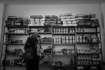 Syrian refugee inside the warehouse of Oasis, a association geared to distributing resources and goods to Syrian refugees in São Paulo.
