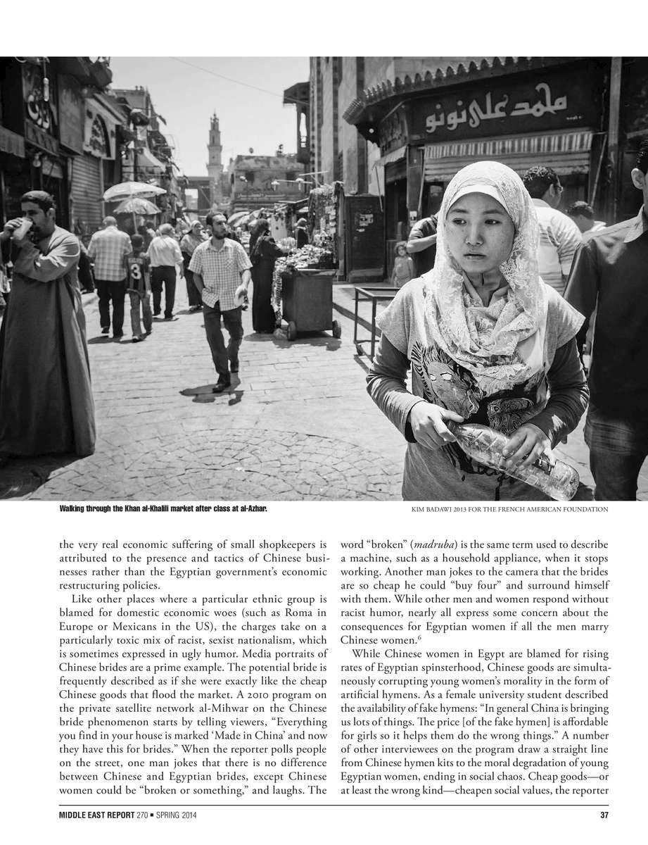 CAIRO, EGYPT - MAY 3 : Titi Zhang, who goes by her Muslim name of {quote}Hagar{quote} , walks thought the Khan el- Khalili market after class at the prestigious school of Al Azhar on May 3, 2012 in Moalin el Ara, in the periphery of Cairo.Egypt, and specifically Cairo's Al-Azhar University, has long been an important destination for Chinese Muslims seeking Islamic learning. The earliest Chinese government-sponsored students to attend Al-Azhar were a group of four sent in 1931.Exchanges were interrupted during the Cultural Revolution, but resumed in 1981; the group of ten sent from China to Al-Azhar that year included three Uyghurs, six Hui, and one Kazakh. By 1992, that number had reached thirty-four students, of whom twenty-eight were Uyghurs. China also provides scholarships to students at other universities, such as Cairo University; some students privately complain that the Chinese government prefers to sponsor those studying science and place various obstacles in the way of those studying religion. If student excel in their Arabic studies they usually chose to reside in Egypt, but for the most part they will return to China at some point in their lives.