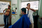 Javier waiting for his haircut.Havana, Cuba