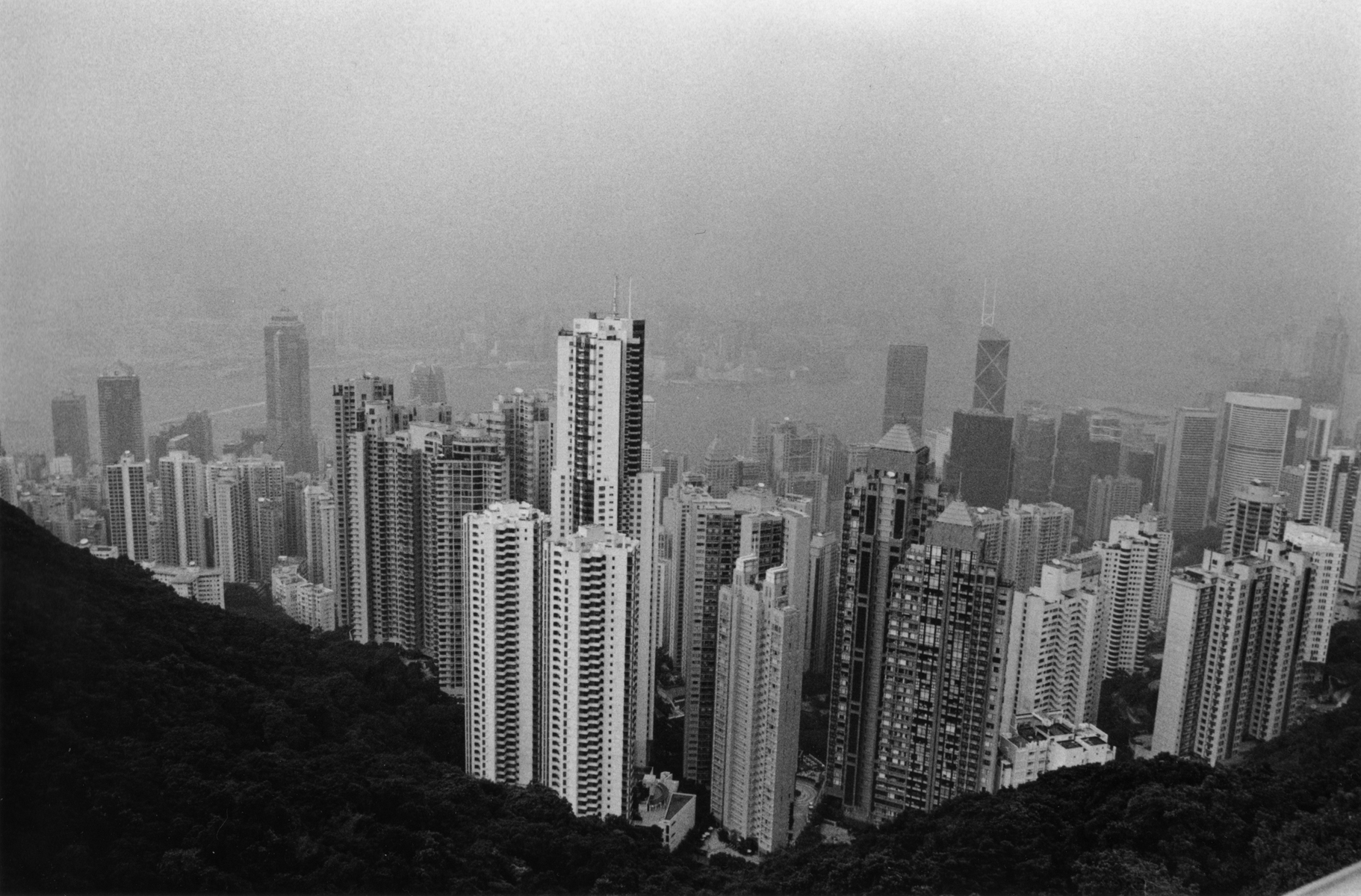 A view of Hong Kong's financial center on top of Victoria Peak. On bright, clear, sunny days The Peak offers panaramic views of Hong Kong, Kowloon, and Victoria harbour. Hong Kong Island