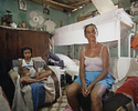 Anaidis and her grandmother, Fermina, sit for their portrait inside their home. Mantilla, Havana, Cuba