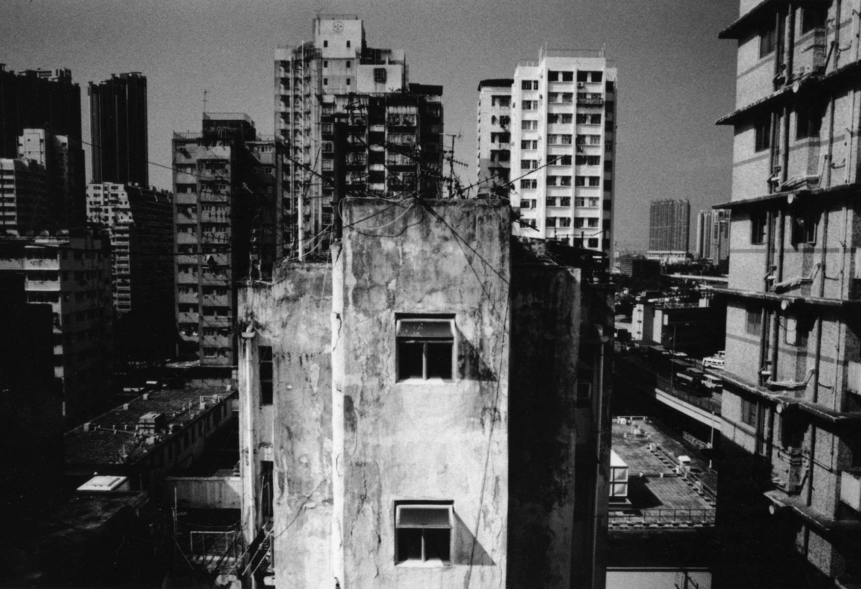 The lower econimic classes living in Hong Kong struggle to find affordable housing, as space is often limited. It is quite common for owners of the building, property managers, or landlords to allow tenants to build illegal appartments on top of roofs of the buildings. The Hong Kong government is now tearing down such habitats and fining the owners of the buidlings. Hong Kong Island