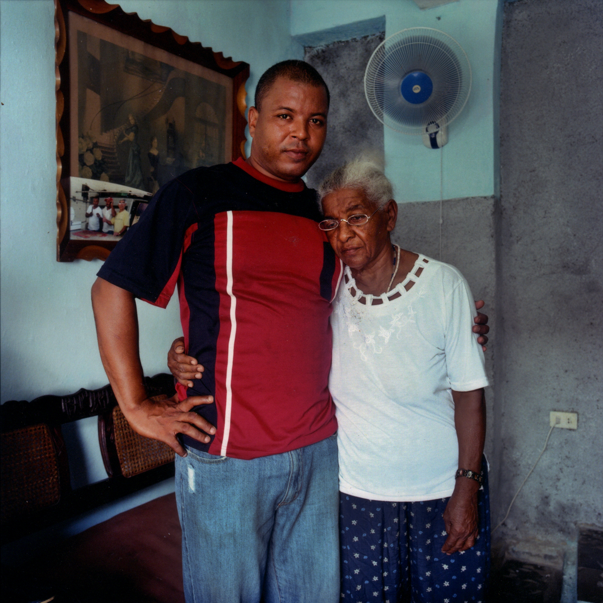 Lorenzo's son, embraces his mother. Havana, Cuba