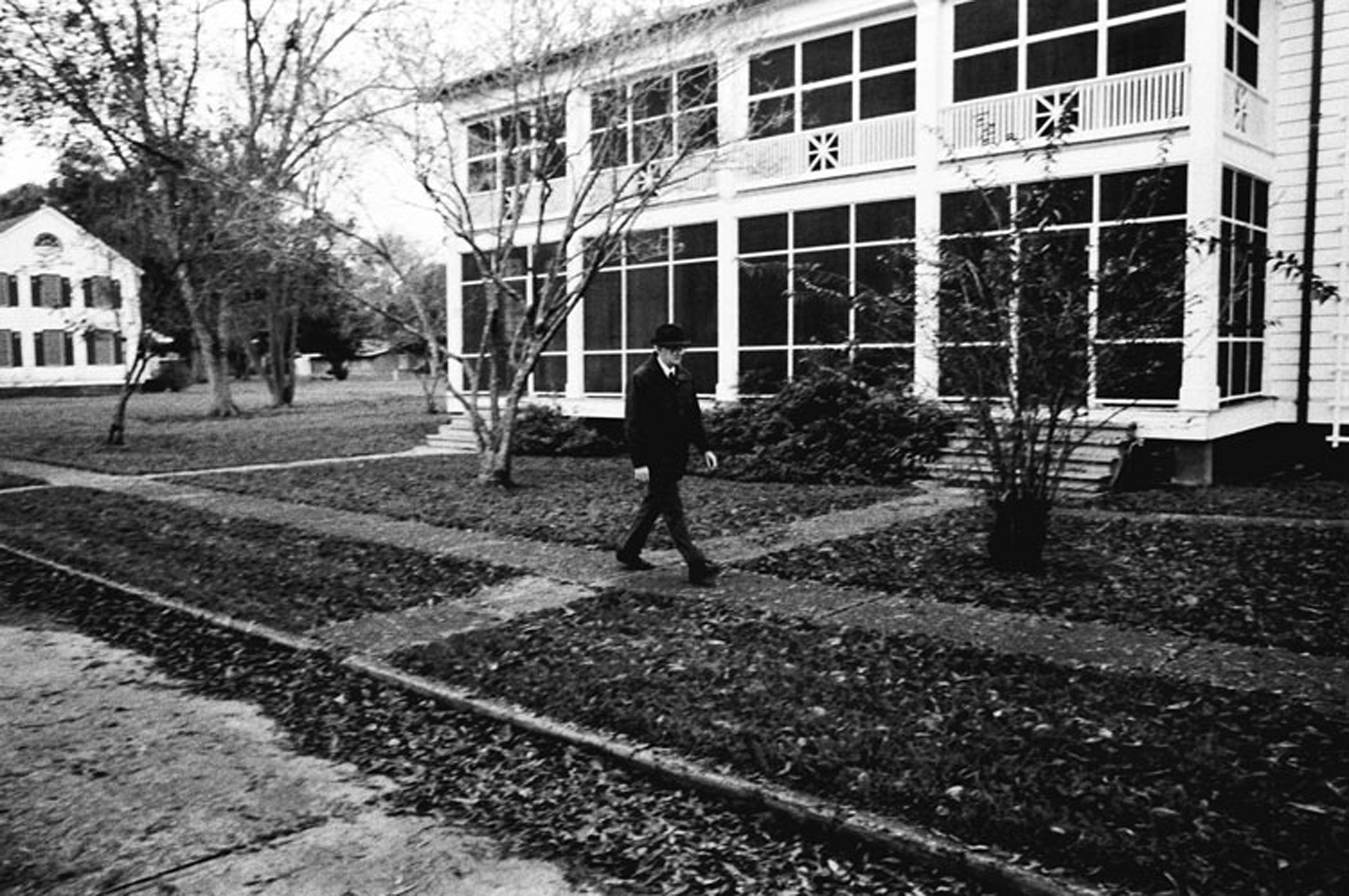 Dr. Clemens, who lives on the grounds of the Leper Colony, walks a few minutes to his office to begin his day.