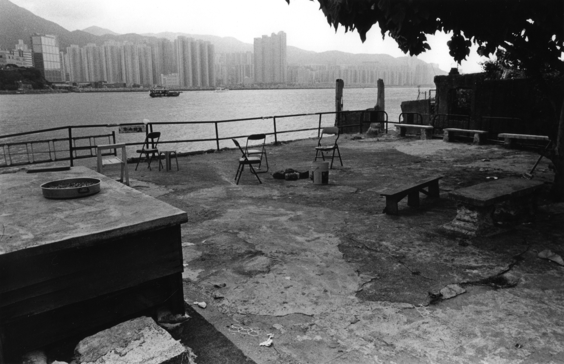 A neighborhood park in the Lei Yue Mun District, known for its seafood markets and fishing villages, overlooks Victoia Bay and the Financial Center of Hong Kong Island. Kowloon Peninsula, Hong Kong